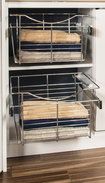 pull out baskets in custom laundry cabinet for sorting laundry