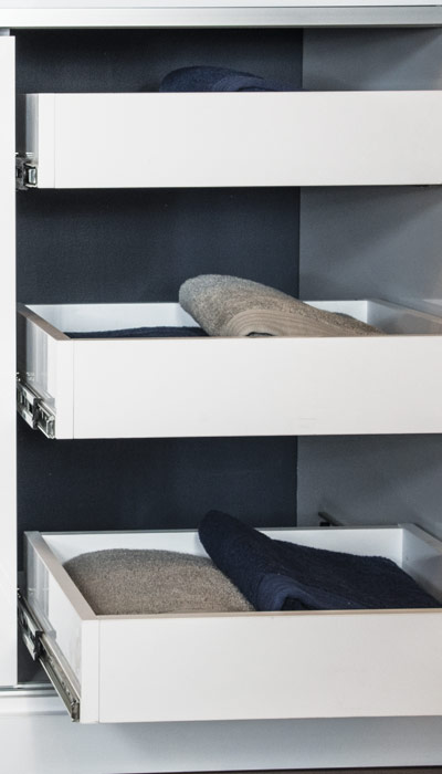 pull out shelves in custom cabinet for laundry