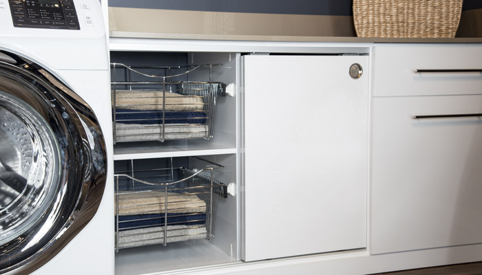 Sliding cabinet for laundry doors on custom laundry cabinetry