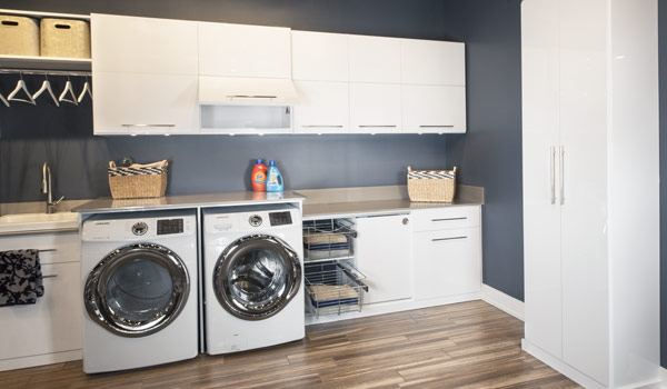 Custom laundry room with fold out ironing board organization system