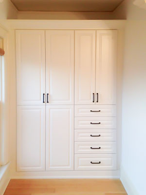 white wardrobe style closet built for an old home