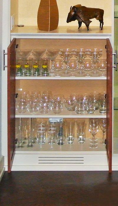 Detail of custom storage for beverage glasses in wall unit