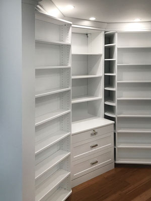custom walk in closet with two 360 organizers