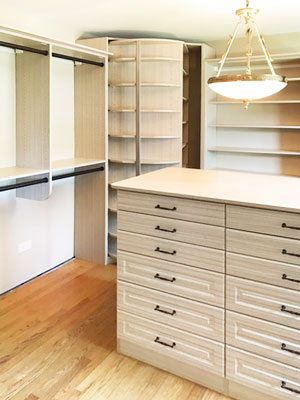 summer breeze walk in closet with traditional drawers