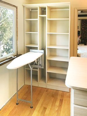 summer breeze walk in closet with built in ironing board