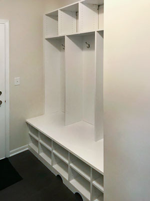 custom white mudroom with access to vent