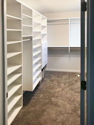 white suspended walk in closet