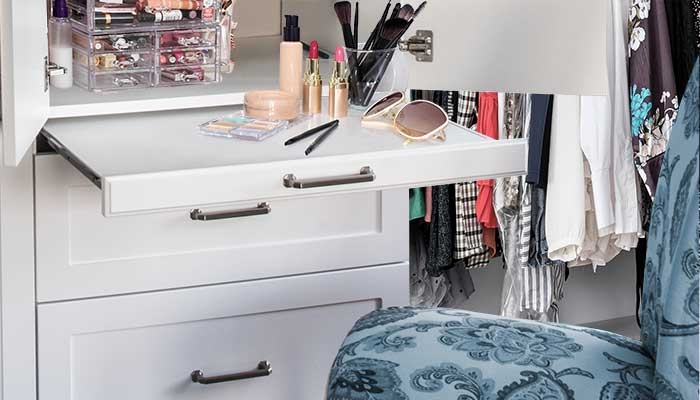 Pull-out shelf used as vanity table in small closet