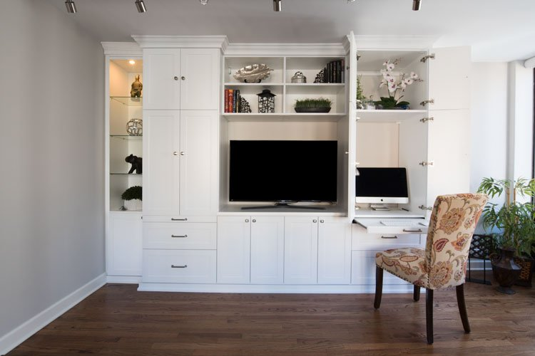 wall unit with desk multitasks as office space