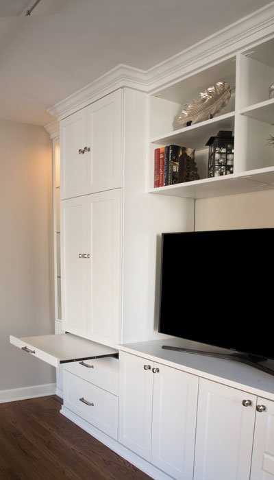 Craft storage cabinet with pull-out desk as homework space.