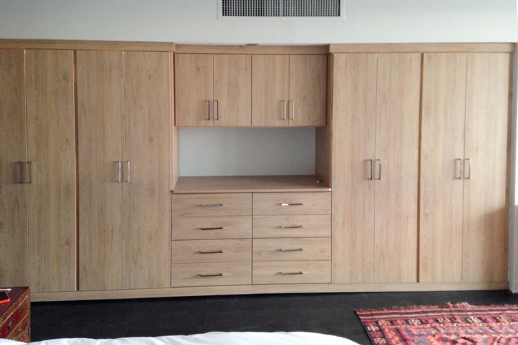 Wardrobe closet in ginger root thermally fused laminate
