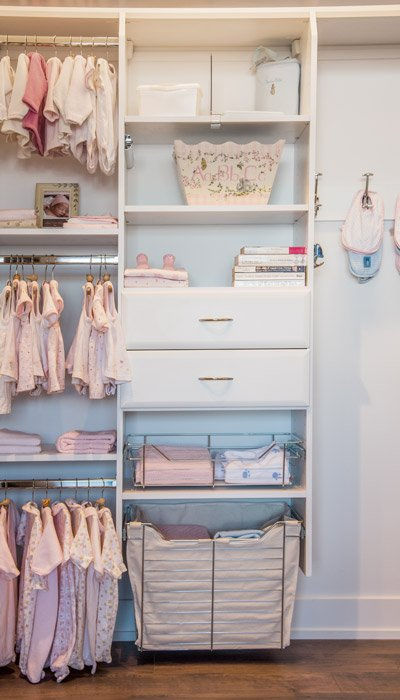 kids closets customized with maximum storage for multiple babies
