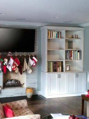 traditional fireplace surround and bookshelves