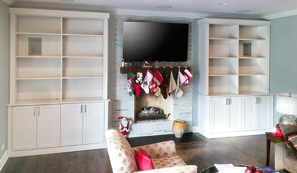 Custom wall unit surounds fireplace