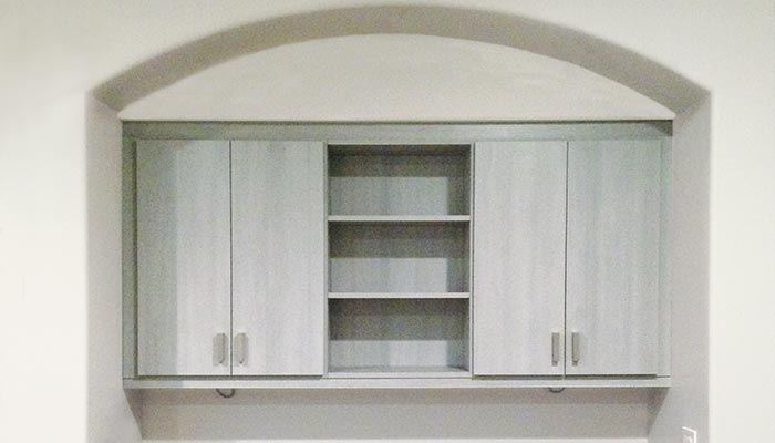 wall unit system for curved ceiling alcove in River Rock thermally fused laminate - TFL