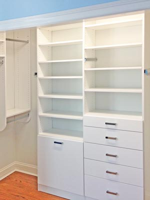 white closet with hanging rod nook