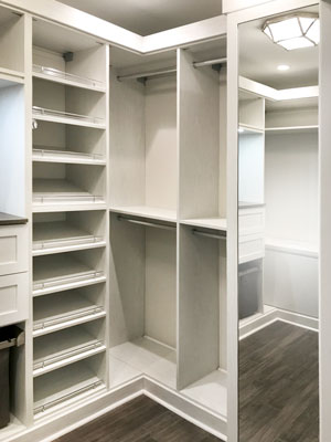 premium luxury closet with slanted shelves and shoe fences