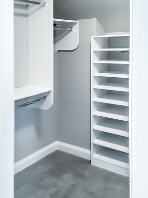 custom closet with angled ceiling and nook