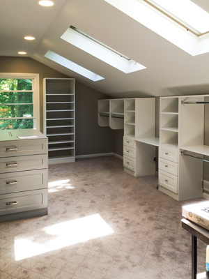 custom sky light closet walk-in with island