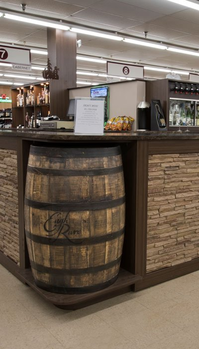 custom barrels and faux stone for beer and wine store decor