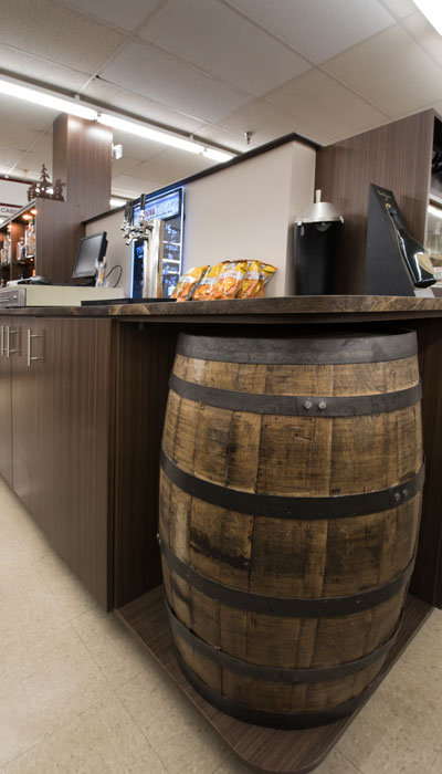 custom hand routed shelves for barrels in beer and wine store