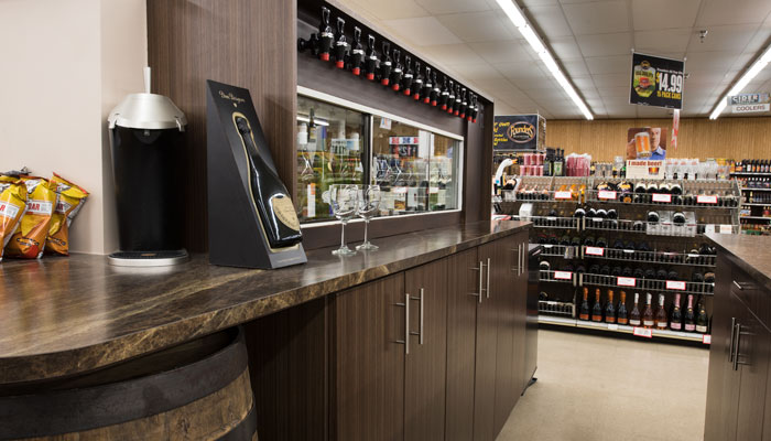 custom wine tasting center and cabinetry for beer and wine store