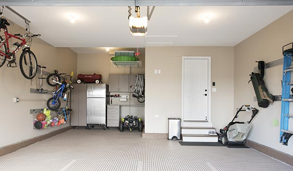garage with custom cabinets and tile floor