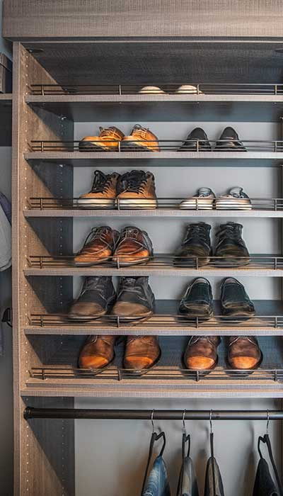 Custom walk-in closet shoe shelves with men's shoes