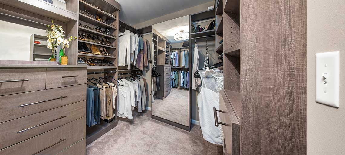 custom walk-n master closet with mirror door closet cabiner and built-in dresser.