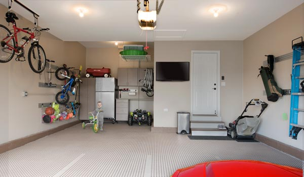 custom garage organization with garage cabinet and tile floor