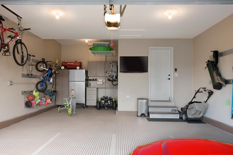 Multi-function garage remodel with toolbench, cabinets, toy and wall storage