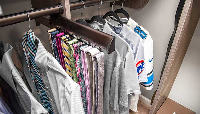 Master bedroom closet ideas for him include a sliding tie organizer