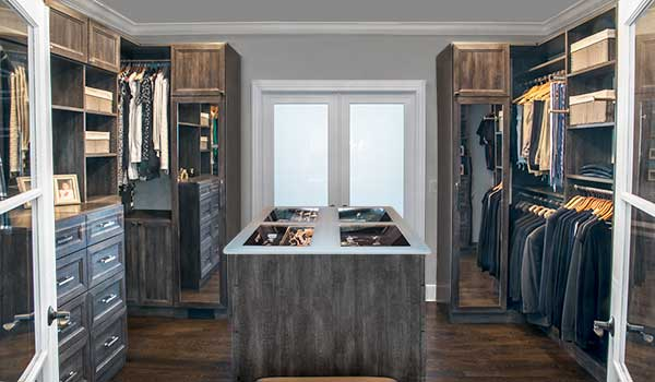 walk through closet with jewelry display in closet island