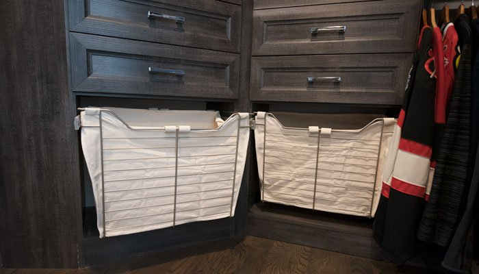 pull-out hamper hides dirty laundry