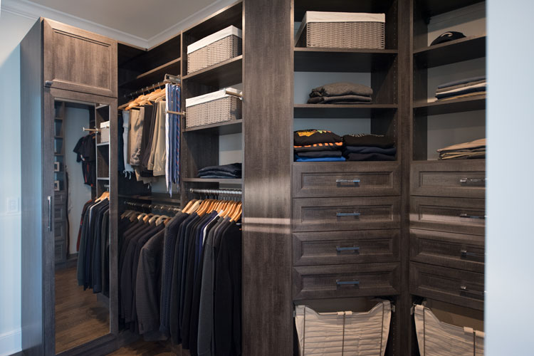 streamlined storage for this walk through closet