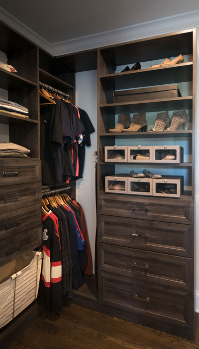 walk through closet with shoe and sock storage
