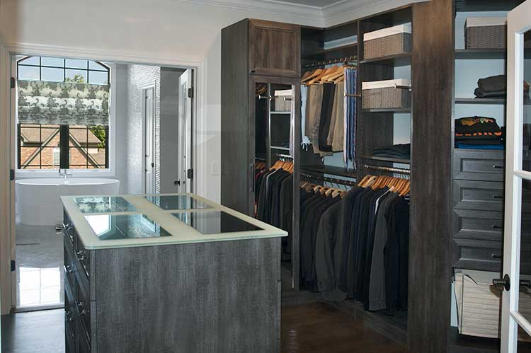 This walk through closet forms an elegant passage to the bathroom