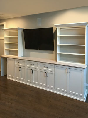 custom ivory media center with cut-out for fridge