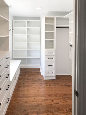 custom walk in closet with shoe organizer