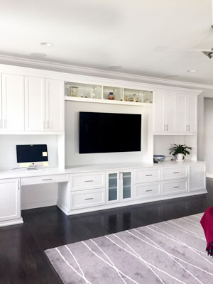 custom family entertainment center and craft storage cabinets