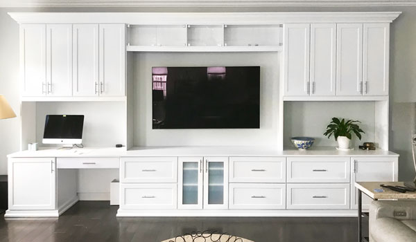 family entertainment center and craft storage cabinets