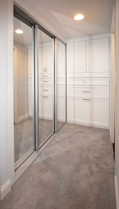 Sliding closet doors with mirrors.