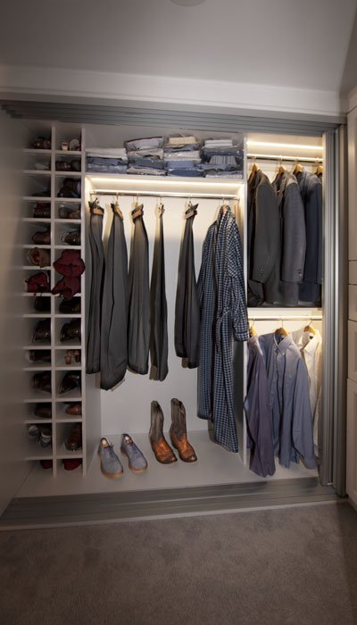 reach-in closet with custom LED lights for him