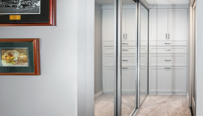 l shaped closet configuration for his side