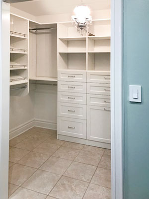 small master walk in closet in white