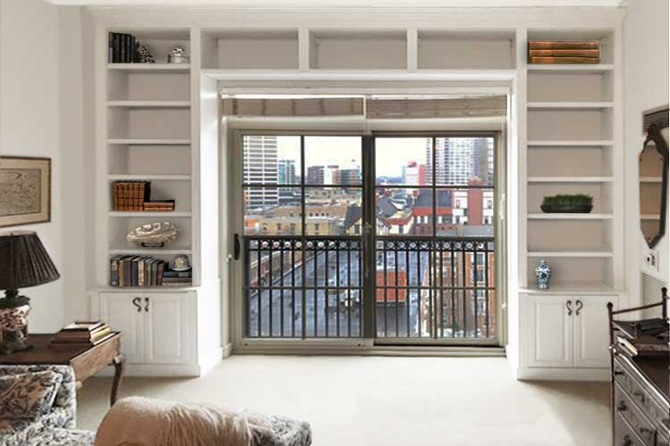wall of bookshelves around patio door