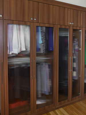custom closet with glass doors