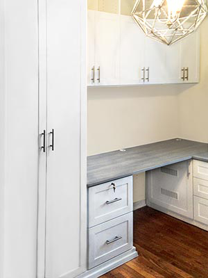 custom home office in white with contrasting gray countertop