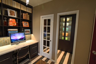 home office space with two computer work stations