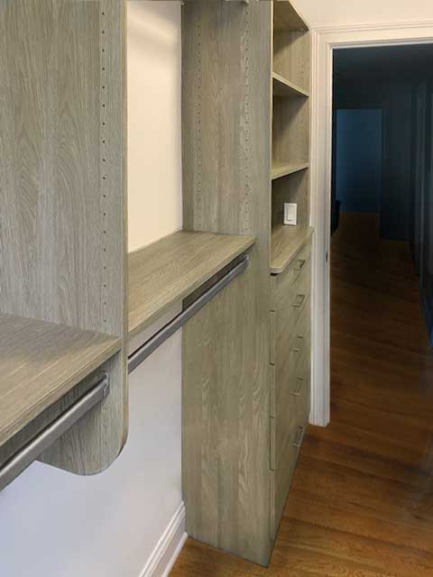 Walk-in closet in Toasted Oak laminate